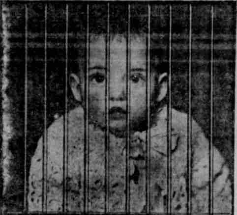 image of Baby Lester behind bars